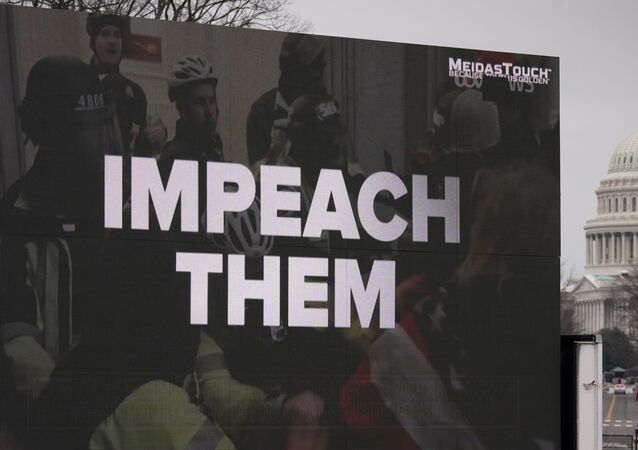 A video screen affixed to a truck flashes an anti-Trump message near the U.S. Capitol during former U.S President Donald Trump's second impeachment trial in Washington, U.S., February 12, 2021