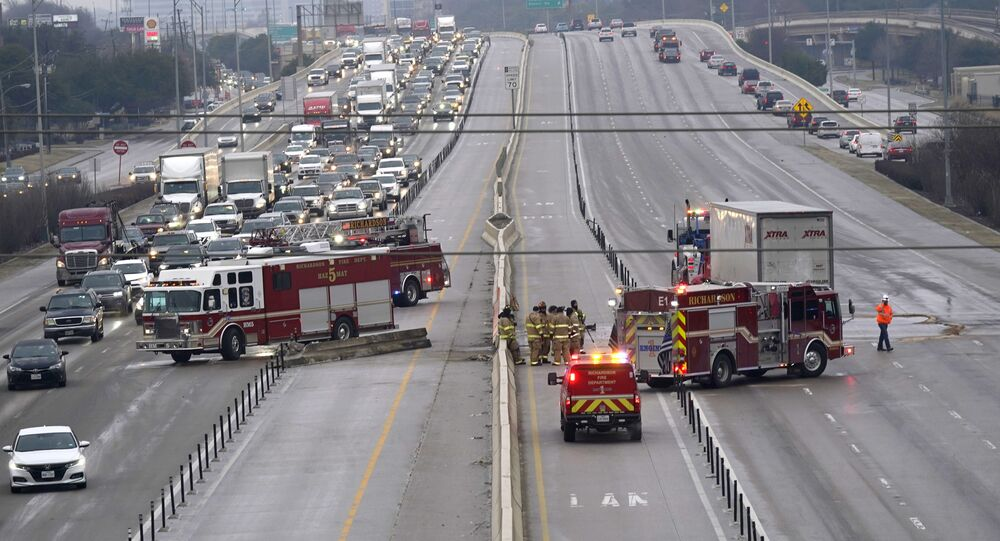 The highway sits closed as emergency crews finish cleaning following accidents caused by ice and low temperatures in Richardson, Texas, Thursday, Feb. 11, 2021. A winter storm brought a coating of ice to parts of Texas. (AP Photo/LM Otero)