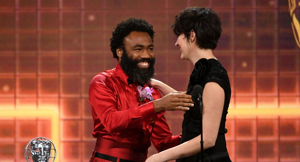 Phoebe Waller-Bridge (R) accepts the Britannia Award for British Artist of the Year from Donald Glover onstage during the 2019 British Academy Britannia Awards presented by American Airlines and Jaguar Land Rover at The Beverly Hilton Hotel on October 25, 2019 in Beverly Hills, California.