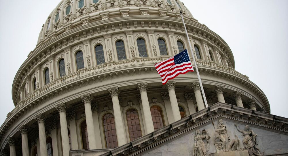 The American flag flies at half staff at the U.S. Capitol Building on the fifth day of the impeachment trial of former U.S. President Donald Trump, on charges of inciting the deadly attack on the U.S. Capitol, in Washington, U.S., February 13, 2021.