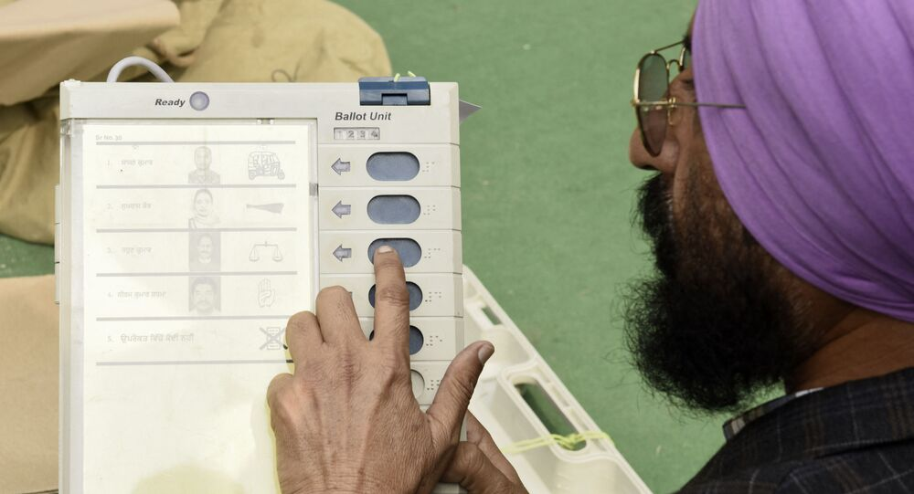 Election officials check Electronic Voting Machines (EVM) at a distribution centre ahead of tomorrow's Punjab Municipal Election, in Amritsar on February 13, 2021.