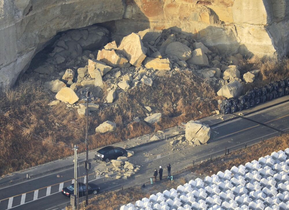 A landslide caused by a strong earthquake blocks Joban Expressway in Soma, Fukushima Prefecture, Japan on 14 February 2021, in this photo taken by Kyodo.