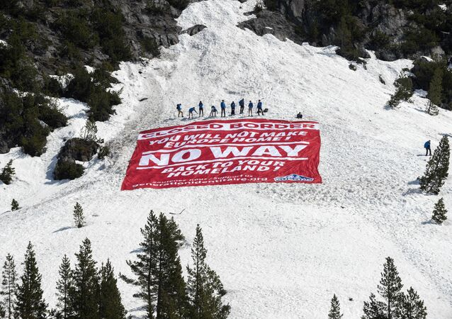 Activists from the French political movement Generation Identitaire (GI) and European anti-migrant group Defend Europe conduct an operation titled Mission Alpes to control access of migrants using the Col de l'Echelle mountain pass on 21 April 2018, in Nevache, near Briancon, on the French-Italian border. Photo by ROMAIN LAFABREGUE / AFP
