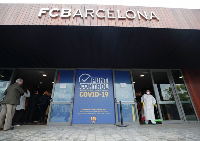 People queue to cast their vote, at a polling station at FC Barcelona's Auditorium, next to Camp Nou stadium, during regional elections in Catalonia, amid the outbreak of the coronavirus disease (COVID-19), in Barcelona, Spain, 14 February 2021. REUTERS/Albert Gea