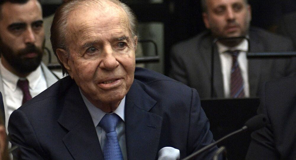 In this file photo taken on February 28, 2019 Argentine former president and current senator Carlos Menem gestures before hearing his sentence during his trial over accusations of attempting to block the 1994 AMIA bombing investigation, in Buenos Aires. - Former Argentine President Carlos Menem (1989-1999) died Sunday in a Buenos Aires clinic at the age of 90, according to the official news agency Telam and other media.