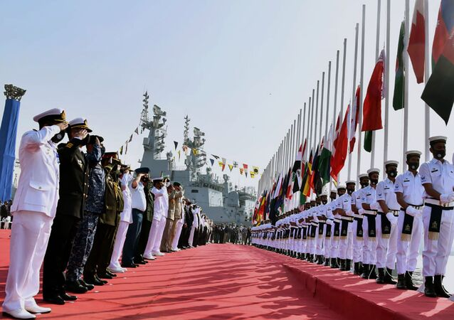 In this photo released by Pakistan Navy shows, military officials from differences countries salute during a flag hosting ceremony for multinational military exercise Aman or Peace, in Karachi, Pakistan, Friday, Feb. 12, 2021. Pakistan's Navy kicked off a five-day multinational military exercise in the Arabian Sea on Friday as part of Islamabad's years-long effort to bring security to the area, it said, although as usual regional archrival India was not invited.