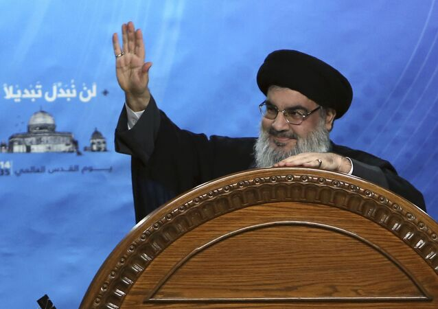 In this July 25, 2014, file photo, Hezbollah leader Sheik Hassan Nasrallah speaks during a rally to mark Jerusalem Day or Al-Quds day, in the southern suburb of Beirut, Lebanon. On Sunday, Nov. 5, 2017 Nasrallah, in a televised speech, said the country's prime minister Saad Hariri was forced by Saudi Arabia to resign