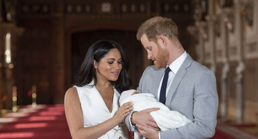 In this Wednesday May 8, 2019 file photo Britain's Prince Harry and Meghan, Duchess of Sussex, pose during a photocall with their newborn son Archie, in St George's Hall at Windsor Castle, Windsor, south England. The Duchess of Sussex has revealed that she had a miscarriage in July. Meghan described the experience in an opinion piece in the New York Times on Wednesday. She wrote: I knew, as I clutched my firstborn child, that I was losing my second. The former Meghan Markle and husband Prince Harry have a son, Archie, born in 2019.