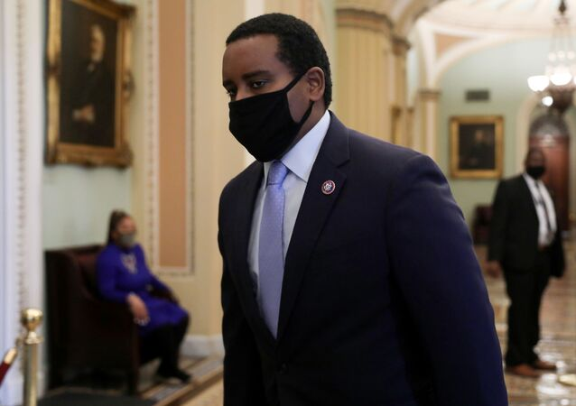 U.S. House impeachment manager Rep. Joe Neguse (D-CO) walks to the U.S. Senate floor for Day Two of the impeachment trial of former U.S. President Donald Trump