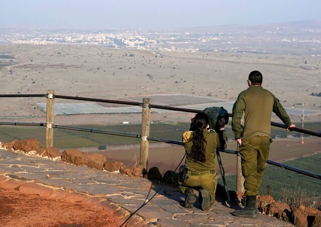 Israeli soldiers look towards Syria across the border from Mount Bental before a visit by U.S. Secretary of State Mike Pompeo and Israeli Foreign Minister Gabi Ashkenazi in the Israeli-occupied Golan Heights November 19, 2020
