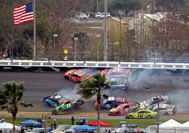 Feb 14, 2021; Daytona Beach, Florida, USA; NASCAR Cup Series drivers Ryan Newman (6), Erik Jones (43), William Byron (24) Tyler Reddick (8), Martin Truex Jr. (19), Aric Almirola (10) and Chris Buescher (17) wreck during the Daytona 500 at Daytona International Speedway.