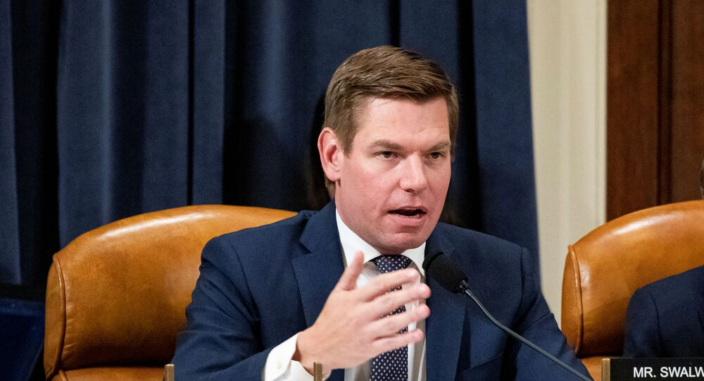 Rep. Eric Swalwell (D-CA) questions a witness during a House Intelligence Committee impeachment inquiry hearing on Capitol Hill in Washington, U.S.,  November 20, 2019