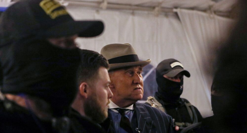 Members of the Oath Keepers provide security to Roger Stone at a rally the night before groups attacked the US Capitol, in Washington, US, 5 January 2021