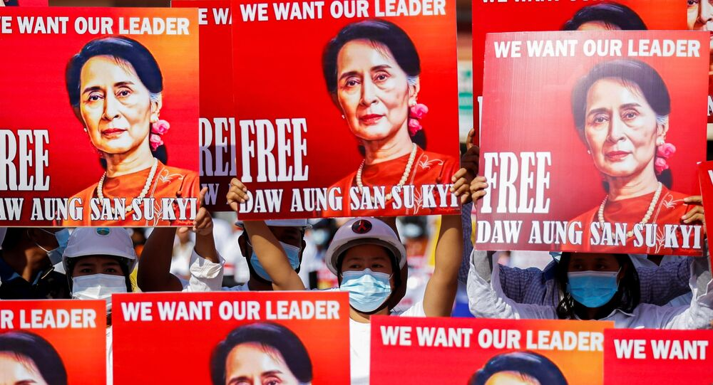 Demonstrators hold placards with the image of Aung San Suu Kyi during a protest against the military coup, in Naypyitaw, Myanmar, February 15, 2021.
