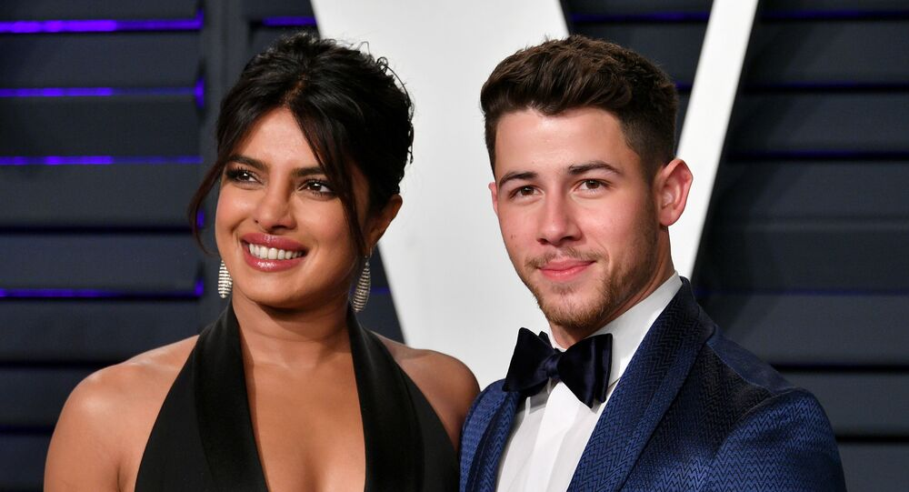 BEVERLY HILLS, CA - FEBRUARY 24: Priyanka Chopra (L) and Nick Jonas attend the 2019 Vanity Fair Oscar Party hosted by Radhika Jones at Wallis Annenberg Center for the Performing Arts on February 24, 2019 in Beverly Hills, California.