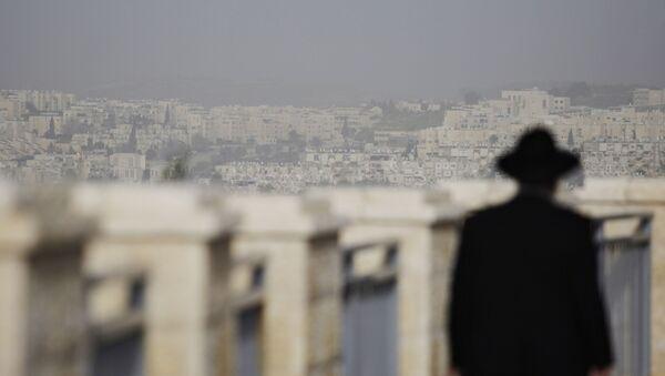 FILE -  In this Wednesday, March 10, 2010 file photo, an ultra-Orthodox Jewish man walks in the east Jerusalem neighborhood of Ramat Shlomo - Sputnik International
