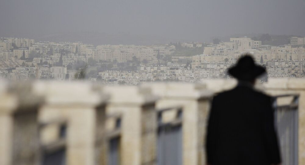FILE -  In this Wednesday, March 10, 2010 file photo, an ultra-Orthodox Jewish man walks in the east Jerusalem neighborhood of Ramat Shlomo