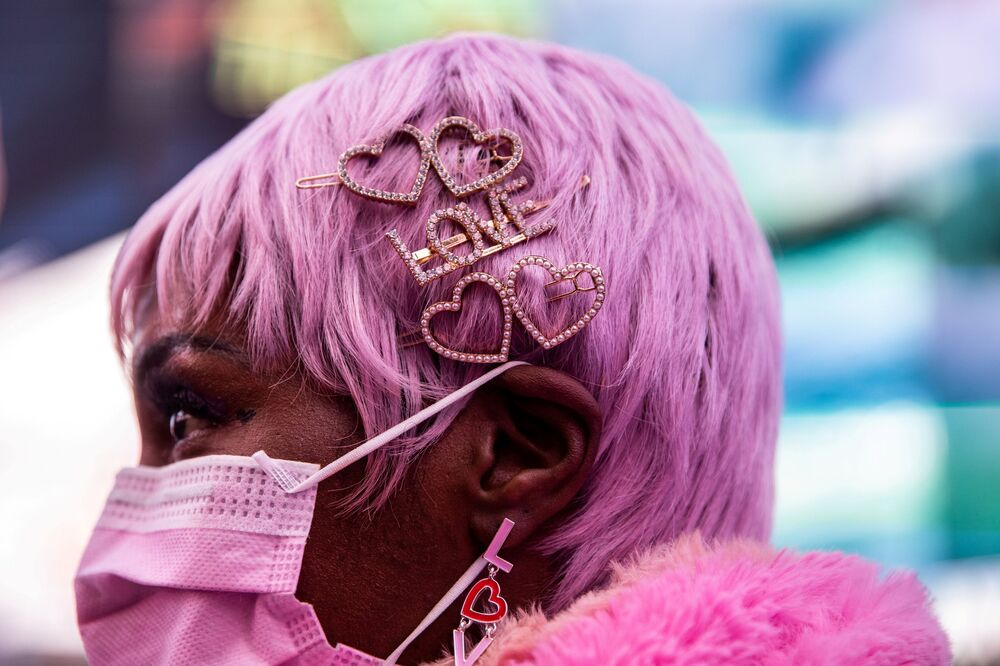 Bernisha Moore wears heart-shaped hair pins during Valentines Day in Times Square in Manhattan, New York City, New York, 14 February 2021.