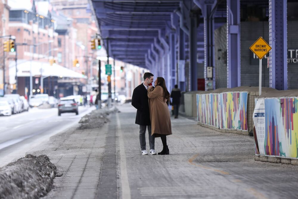 A couple pauses on a walk to embrace on Valentine's Day during the coronavirus disease (COVID-19) pandemic, in the Manhattan borough of New York City, New York, on 14 February 2021.