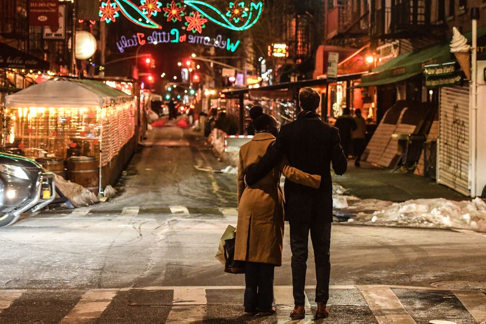 A couple waits to cross the street on Valentine's Day, 14 February 2021, in New York's Little Italy neighbourhood. Despite the ongoing COVID-19 pandemic, couples are still out celebrating Valentine's Day.
