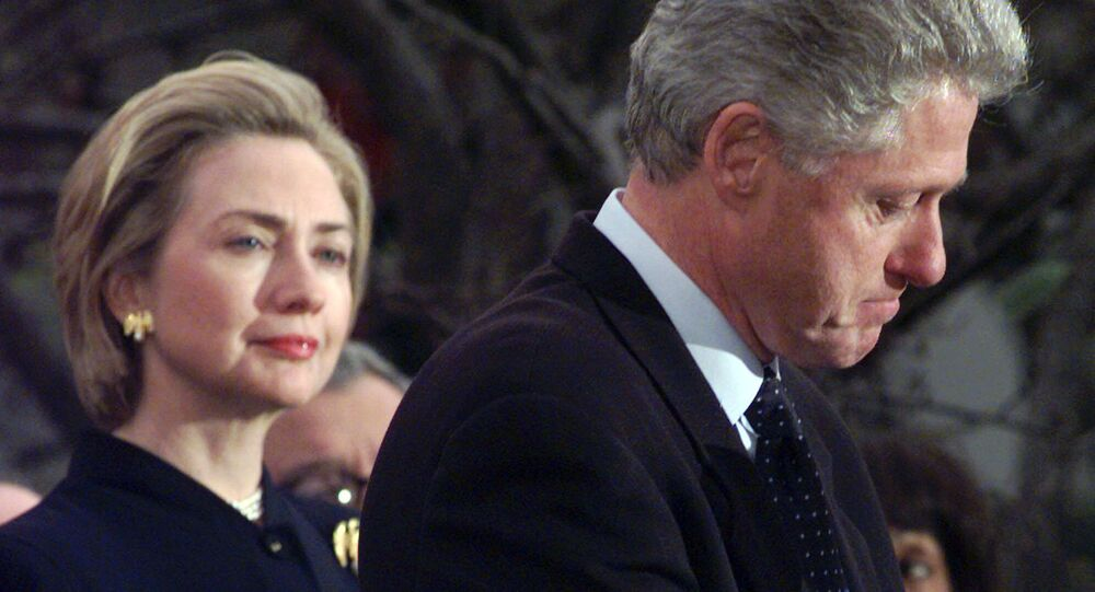 First lady Hillary Rodham Clinton watches President Clinton pause as he thanks those Democratic members of the House of Representatives who voted against impeachment in this Dec. 19, 1998 file photo