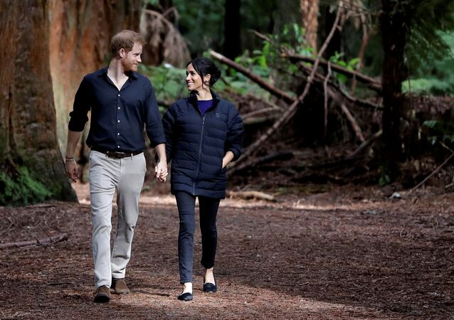 Britain's Prince Harry and Meghan, Duchess of Sussex walk through a Redwoods forest in Rotorua, New Zealand, Wednesday, Oct. 31, 2018