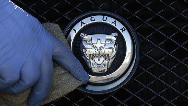 FILE - In this file photo dated Wednesday, 28 September 2016, a worker polishes a Jaguar logo on a car at a Jaguar dealer outlet in London - Sputnik International