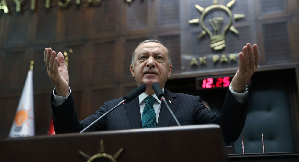 Turkish President Tayyip Erdogan addresses members of parliament from his ruling AK Party (AKP) during a meeting at the Turkish parliament in Ankara, Turkey, February 10, 2021