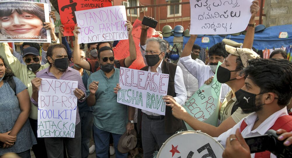 Historian, author and activist Ramachandra Guha (C) and various human rights organisation stage a demonstration against the arrest of the activist Disha Ravi by Delhi police for her alleged involvement in the instigation of violence during the farmers protest on India's Republic Day, in Bangalore on February 15, 2021.