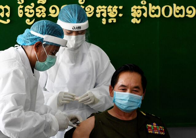 A four-star general receives the Sinopharm vaccine from China during the first day of vaccinations against the Covid-19 coronavirus at a hospital in Phnom Penh on February 10, 2021.