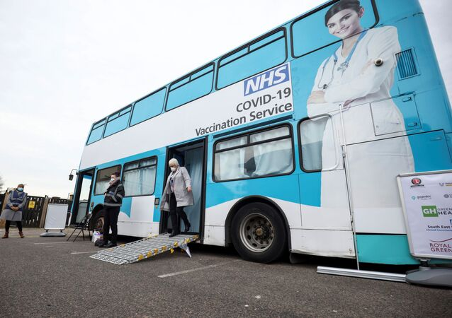 A person gets off a mobile vaccination centre for the coronavirus disease (COVID-19) after receiving the vaccine, in Thamesmead, London, Britain, February 14, 2021.