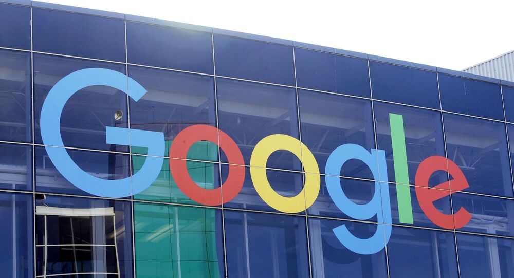 In this Sept. 24, 2019, file photo a sign is shown on a Google building at their campus in Mountain View, Calif. Google is formally pushing back on antitrust claims brought against it by the Justice Department two months ago.