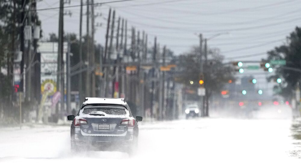 Vehicles drive on snow and sleet covered roads Monday, Feb. 15, 2021, in Spring, Texas.