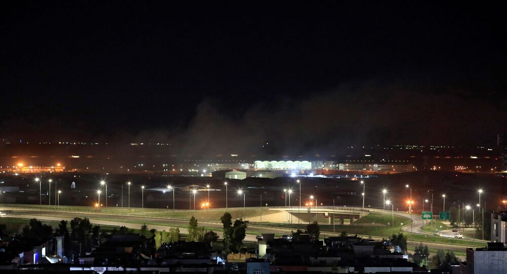 Smoke rises over the Erbil, after reports of mortar shells landing near Erbil airport, Iraq, 15 February 2021.