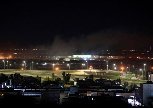 Smoke rises over the Erbil, after reports of mortar shells landing near Erbil airport, Iraq February 15, 2021.