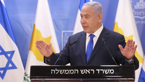 Israeli Prime Minister Benjamin Netanyahu delivers a joint statements with Cypriot President Nicos Anastasiades (not pictured) in Jerusalem February 14, 2021. - Sputnik International