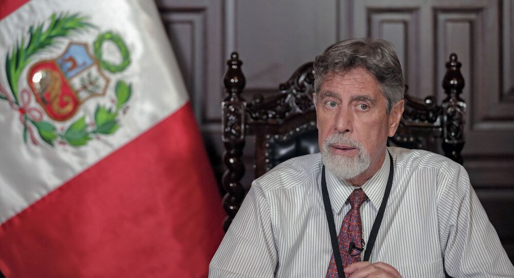Handout picture released by the Peruvian Presidency press office showing President Francisco Sagasti delivering a televised message to the nation regarding the new measures to control the spread of the COVID-19 coronavirus pandemic, the patients care, and vaccination of the population in Lima on January 26, 2021.