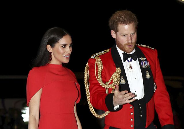 Britain's Prince Harry and Meghan, Duchess of Sussex arrive at the Royal Albert Hall in London, Saturday March 7, 2020, to attend the Mountbatten Festival of Music