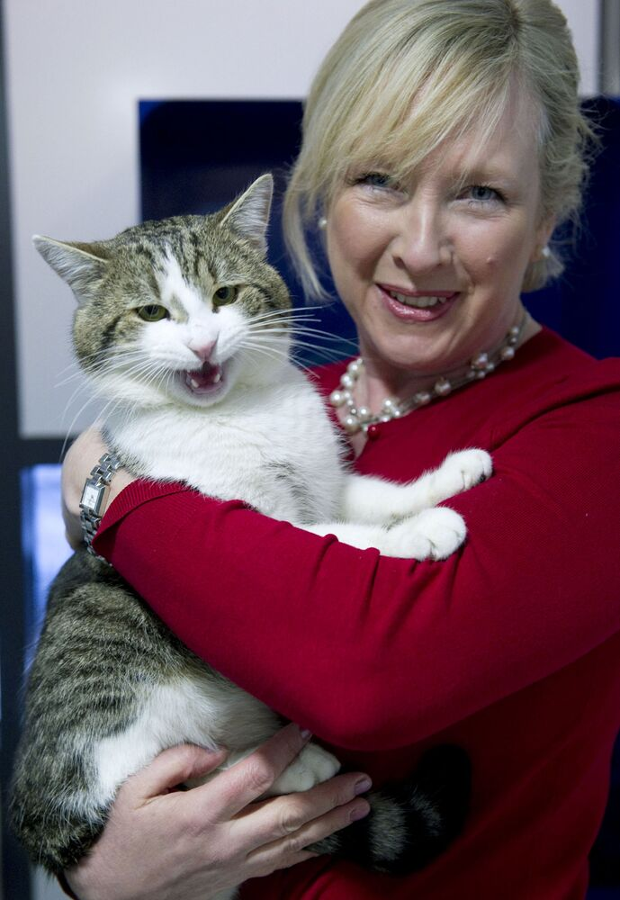 Claire Horton, CEO of Battersea Dogs and Cats Home in London, holds 'Larry' before he is taken to the British Prime Ministers residence, 10 Downing Street, on Tuesday 15 February 2011.