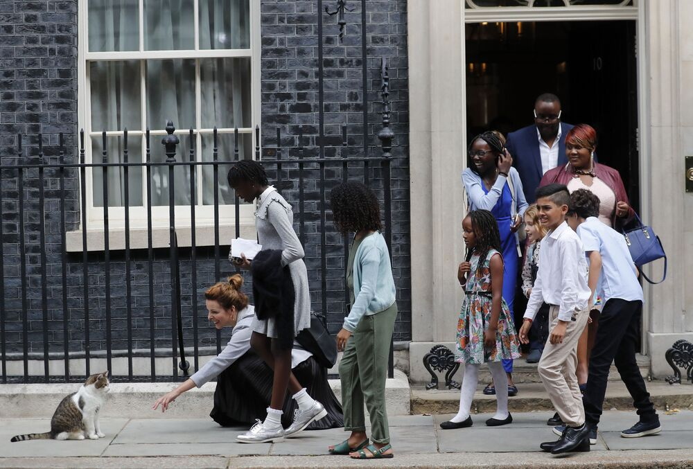 School children approach Downing Street chief mouser Larry the cat, as they leave after a scheduled meeting with Britain's Prime Minister Boris Johnson at 10 Downing Street in London, 30 August 2019.