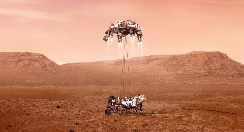 This illustration provided by NASA shows the Perseverance rover, bottom, landing on Mars.