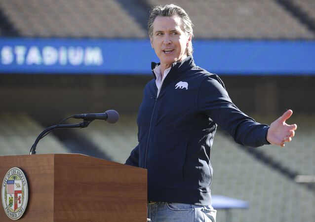 Governor Gavin Newsom addresses a press conference held at the launch of a mass COVID-19 vaccination site at Dodger Stadium on Friday, Jan. 15, 2021, in Los Angeles
