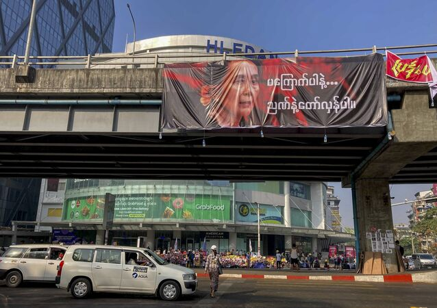 A picture of detained Myanmar leader Aung San Suu Kyi is displayed at an intersection against the military coup in Yangon, Myanmar Tuesday, Feb. 16, 2021.