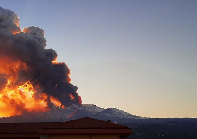 Ash spews from Mount Etna as Europe's most active volcano erupts as seen from Riposto, Italy, February 16, 2021 in this image taken from social media.