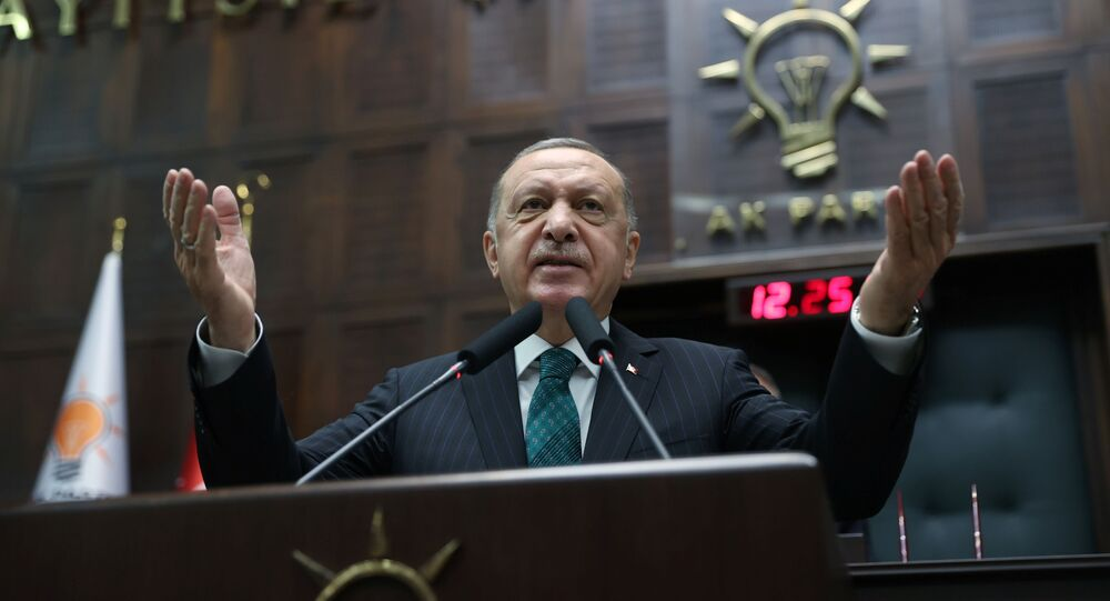 Turkish President Tayyip Erdogan addresses members of parliament from his ruling AK Party (AKP) during a meeting at the Turkish parliament in Ankara, Turkey, February 10, 2021.