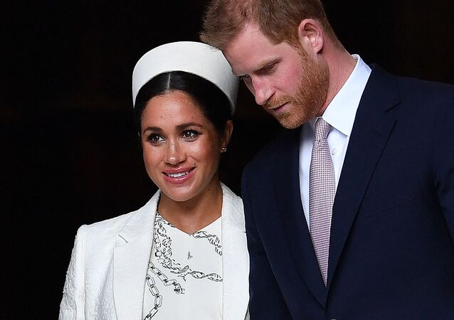 In this file photo taken on March 11, 2019 Britain's Prince Harry, Duke of Sussex (R) and Meghan, Duchess of Sussex leave after attending a Commonwealth Day Service at Westminster Abbey in central London.