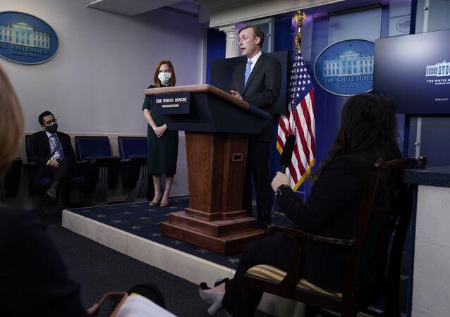 White House press secretary Jen Psaki listens as National security adviser Jake Sullivan speaks during a press briefing at the White House, Thursday, Feb. 4, 2021, in Washington.