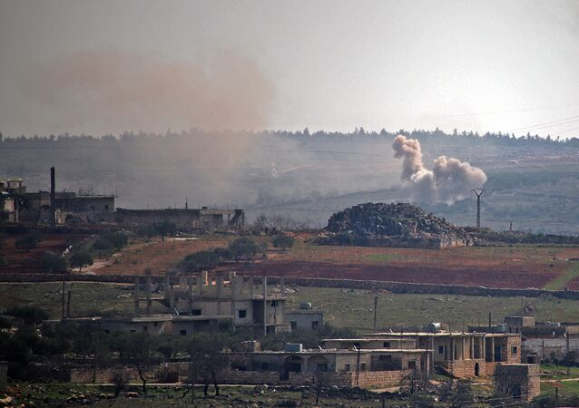 Smoke billows following reported shelling by government forces on the northwestern Syrian town of Barah, in the rebel held Idlib province on February 12, 2021.