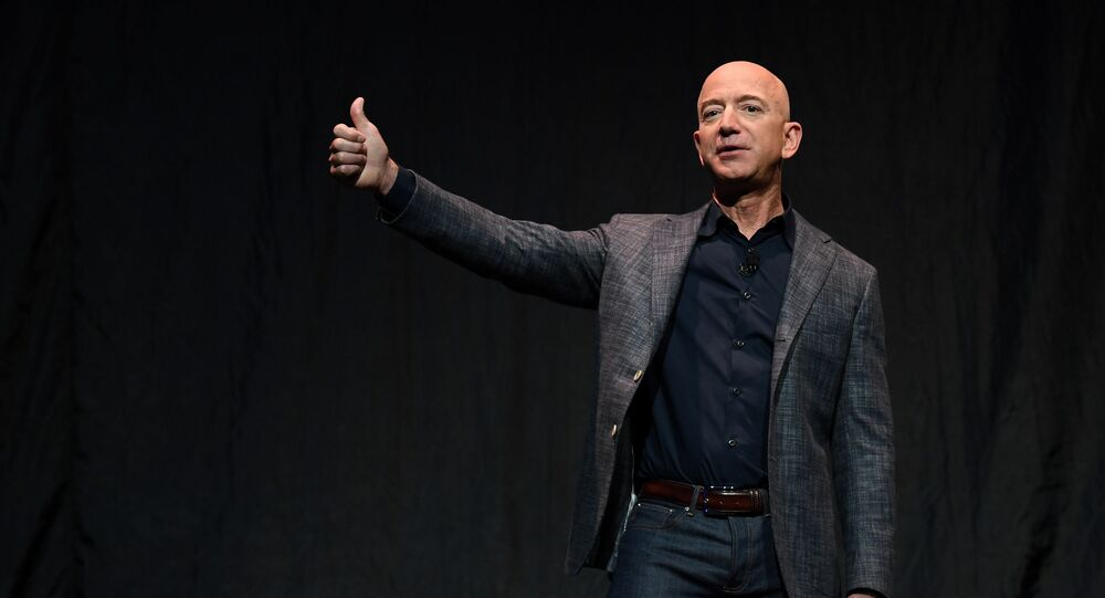 Founder, Chairman, CEO and President of Amazon Jeff Bezos gives a thumbs up as he speaks during an event about Blue Origin's space exploration plans in Washington, U.S., May 9, 2019.