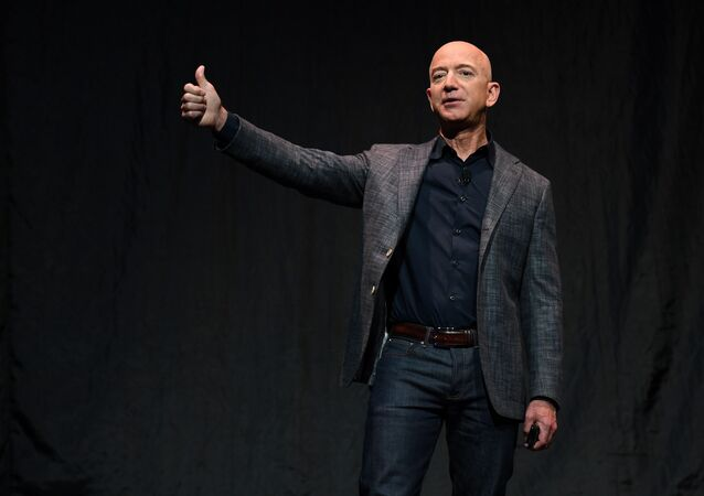 Founder, Chairman, CEO and President of Amazon Jeff Bezos gives a thumbs up as he speaks during an event about Blue Origin's space exploration plans, 9 May 2019.